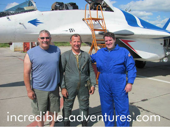 Brothers Doug and John pose in front of the MiG-29 with Sokol Test Pilot Yuri Polyakov. They flew in July 2014.