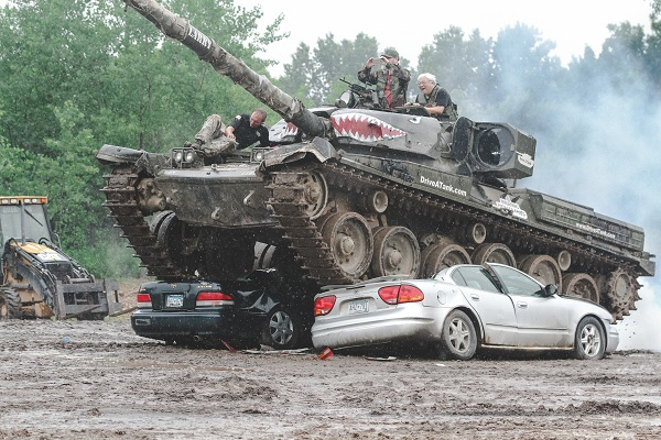Media drive tanks & crush cars in Minnesota