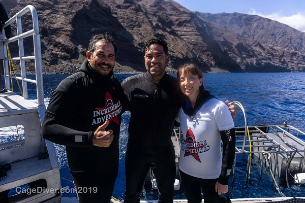 Greg and Rebecca Claxton with crewmember on shark cage diving expedition in Guadalupe, Mexico.